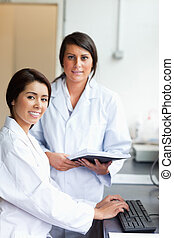 Portrait of scientists with a report in a laboratory
