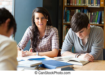 Young adults studying in a library