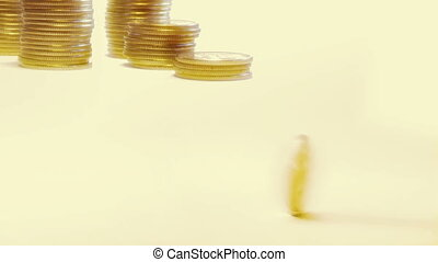 rotating coin against stacks of coins Zoom out and static...
