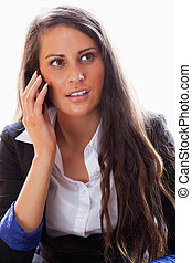 Portrait of a surprised woman on the phone while looking...