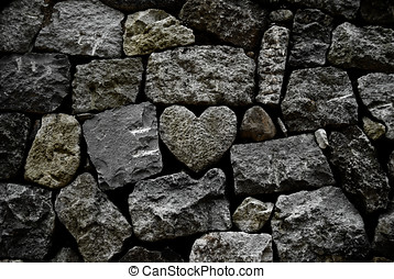 Grunge rock heart on stone wall - stone wall with a...