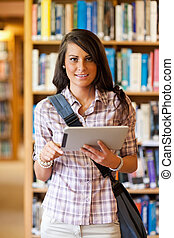 Portrait of a smiling young student using a tablet computer