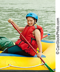 rafting on the raft - Girl with a paddle on the raft