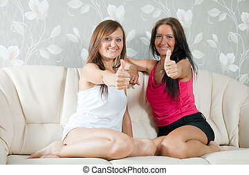 happy mid adult women showing thumb up - Two happy mid adult...