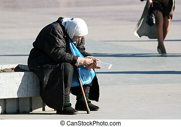 Homeless old woman - Homeless elderly woman on a city street