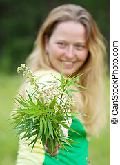 Woman holds  cannabis