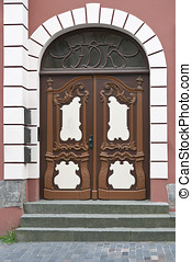 Brown Door - Brown double door with wood carving Shot from...