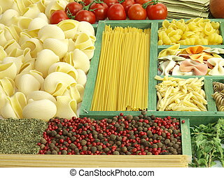 Pasta collection in wooden box and ingredients for cooking