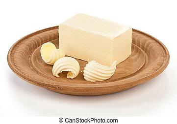 Burro su piatto di legno - Burro sul piatto di legno