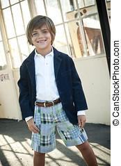 happy boy - handsome 7 yr old boy wearing plaid shorts,...