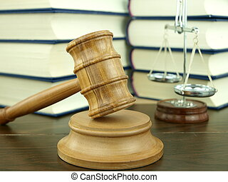 Judges Gavel and scale of justice with a stack of legal...