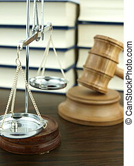 Judge?s Gavel and scale of justice with a stack of legal books background