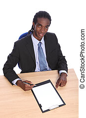 Young African American businessman at office desk - Working...