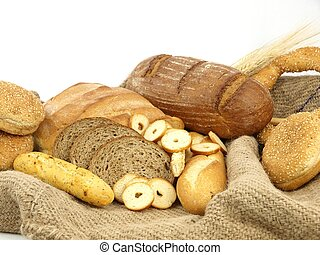 Various types of bread and other wheat products in a burlap...