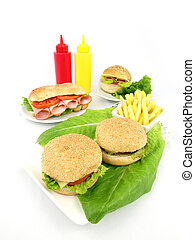 Fast food meal of hamburger, turkey sandwich and fries