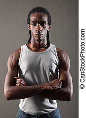 Tough muscles on mean young African American man - Shoulder...