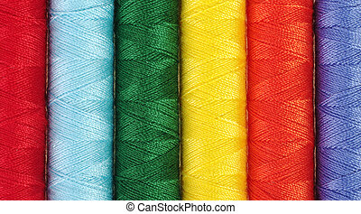 Closeup of different colored sewing thread