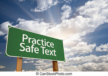 Practice Safe Text Green Road Sign with Dramatic Sky, Clouds...