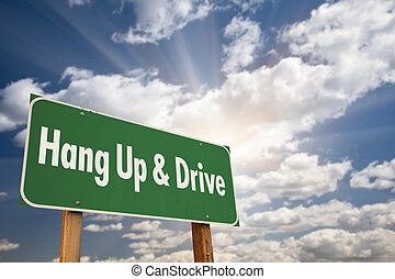 Hang Up and Drive Green Road Sign with Dramatic Sky, Clouds...
