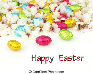 Happy Easter card with chocolate eggs and spring flowers