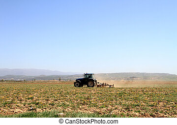 Plowing - A tractor ploughing a field