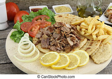 Greek gyros - Plate of traditional Greek gyros with meat,...