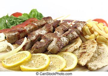 Greek skewer (souvlaki) - Plate of traditional Greek skewer...