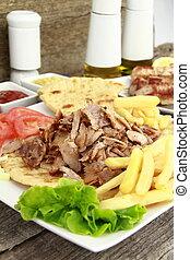 Greek gyros - Plate of traditional Greek gyros or Turkish...