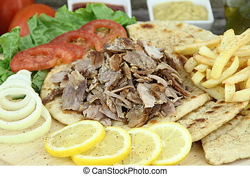 Greek gyros - Plate of traditional Greek gyros or Turkish...