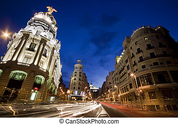 Gran via street, Madrid, Spain. - Rays of traffic lights on...