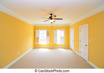Unfurnished Room - An unfurnished bedroom with yellow walls