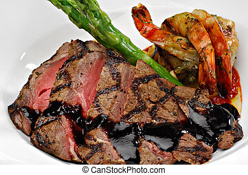 Surf and Turf - Sliced steak topped with a red wine...