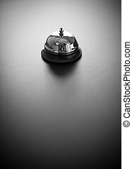 Service Bell - Shiny service bell on a gray background