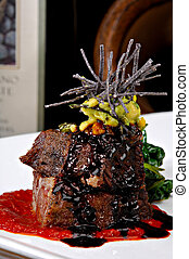 Plated short ribs - Stacked braised short ribs on a bright...