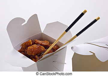 Chinese Takeout - Orange chicken in a white takeout...