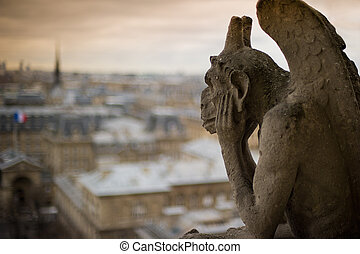 Gargoyle - Stone gargoyle with horns, perched on a corner of...