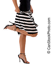 Leggs of woman in striped skirt - Woman wearing a black and...
