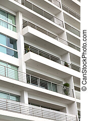 Detail of a modern multi-storey apartment building with...