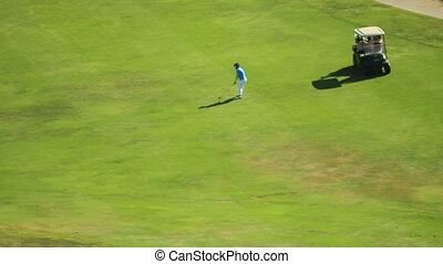 REC-0054 golfer swings from fairway
