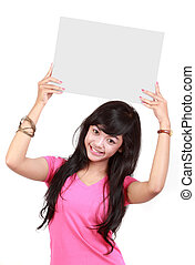 Portrait of a cute young woman holding a blank card