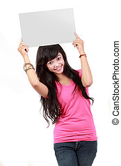 Portrait of a cute young woman holding a blank card up on her face isolated over white background