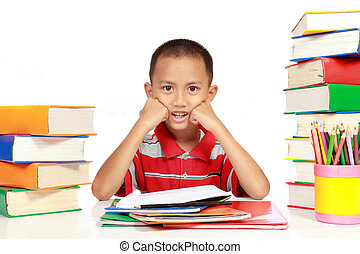 little boy with his homework, with a lot of books around...