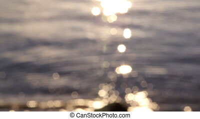 Starburst Water 3 - Out of focus star burst reflections from...