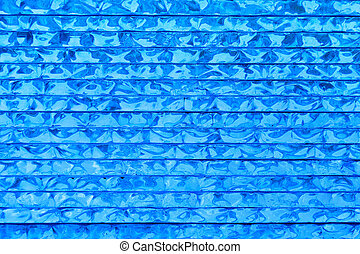 blue glass background - abstract pattern of blue glass...