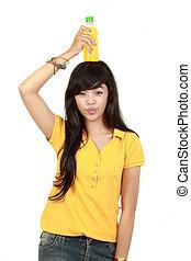 Woman holding orange juice smiling showing orange juice product