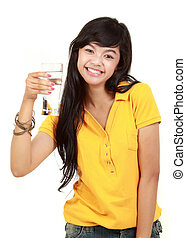 young girl holds a glass of water