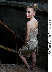 Sexy young woman in evening dress posing - Young girl in...