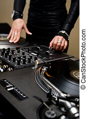 Female rnb deejay playing turntables - Chick spinning the...