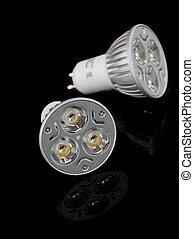 LED light bulbs over black background