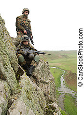 Two soldiers on the cliff